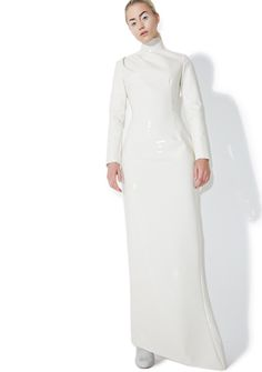 Maria ke Fisherman Creme PVC Dress makes ya feel invincible. This jaw dropping long sleeve maxi dress was beautifully made by hand in Spain with a sleek 'N sexXxy PVC consrtruction that's lined in a smooth mesh material. Featurin' a curve huggin' slim fit, high neckline, ruched shoulder detail, asymmetric hemline and a stunning full back zipper closure. Super exXxclusive limited quantities, so don't miss out on this bb!