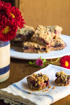 Easy strawberry oat crumble bars with toasted coconut and candied ginger chips, by The Wimpy Vegetarian. #SundaySupper