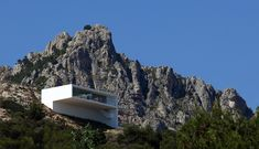 Gallery of House on the Cliff.  Beautiful home.  Too bad it looks devoid of life.