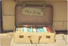 This is the easiest Library to make...ever. We don't know anyone who has actually done this yet, but it's a great idea! If it rains, just move it inside. You could even carry it around town and be the local book fairy. :)