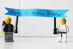 lego guys hold birthday cake topper. easy alternative to writing on the cake.