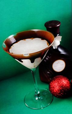Godiva Chocolate Martini  From Drinks Mixer.com  Ingredients:      1 1/2 shots Godiva® chocolate liqueur     1 1/2 shots creme de cacao     1/2 shot vodka     2 1/2 shots half-and-half  Preparation: Garnish with chocolate syrup and white chocolate chips in the bottom of the glass. Mix all ingredients in a shaker with ice, shake and pour into a chilled cocktail glass.