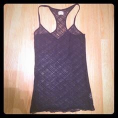 Intimately Free People Navy Lace Tank Gently worn, good condition. Adorable lace criss cross patterned fabric. Wear it under a crop top as a layering piece or as a sexy night top. A great basic! Free People Tops Tank Tops