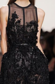 Fashion haute couture embroidered black lace dress. Amazing and stunning dress for chic and elegant women. Black dress on the runway.