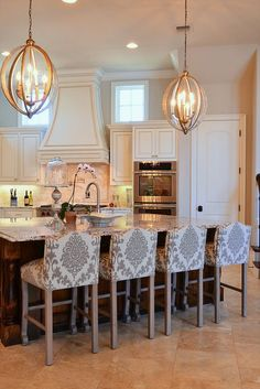 Kitchen Decor: White cabinets, chandeliers and those chairs!