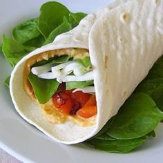 Get Rolling! Wraps are an easy way to sneak more veggies and healthy ingredients into your main course. Stuff, roll, devour, repeat. Try this Hummus Artichoke Wrap!