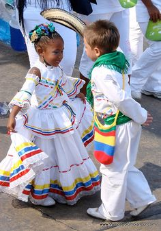 Cute Cumbia dancers at Barranquilla Carnaval in Colombia (important folklore celebration, one of the biggest carnivals in the world. The carnival has traditions that date back to the century).
