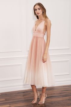 Marchesa Notte Spring 2018 RTW: Feminine and girly peach a line dress with intricate knife pleats.