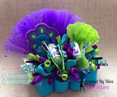 Gorgeous peacock funky loopy hair bow!!  https://www.facebook.com/bowmakindiva/photos/a.875801882459056.1073741881.664051576967422/875809832458261/?type=3&theater