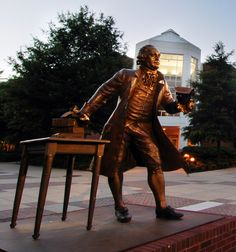 The famous statue of George Mason, a landmark on the Fairfax Campus.  George Mason drafted the Virginia Declaration of Rights, which became a model for the first ten amendments to the U.S. Constitution know as the Bill of Rights.
