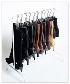 The Boot Rack - cool hanging boot storage idea. Might have to put some foam or padding under the clips though to prevent seeing crease marks in your leather.