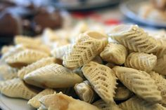 """Moroccan pastries """"s'bat l'cadi"""" (caid's slippers). A thin and flexible cookie dough filled with marzipan, the designs are pinched one row at a time with a toothed pinscher.  almond pastries by Serenae on Flickr."""