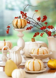 Place mini white or orange-stripe pumpkins on white candlesticks and dishware for a fun centerpiece. More Thanksgiving centerpieces: http://www.midwestliving.com/homes/seasonal-decorating/holiday-ideas/easy-thanksgiving-centerpieces/?page=4
