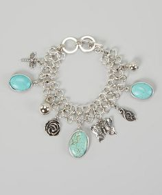 Another great find on #zulily! Silver & Turquoise Oval Stone Butterfly Charm Bracelet #zulilyfinds