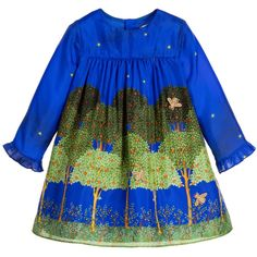 Baby girls electric blue and gold printed silk dress by Gucci. This beautiful design depicts a wonderful forest at night scene. The trees are covered with fruits and there are gold bee appliqué to further embellish the fabric. The long sleeves are gently elasticated at the wrists and there is back button fastening, with a cotton lining for comfort.