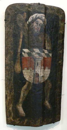 Barfüßiger Wilder Mann mit Turban, zum Schlag ausholende Rechte mit Keule, die Linke hinter umgehängten Schild mit dem Wappen der Stadt Deggendorf. Süddeutsch, um 1450 (Bayerisches Nationalmuseum München; Inv. Nr. W 284)