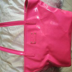 SALE kate spade new York tote. Bright pink authentic Kate Spade tote. Perfect for that extra pop of color. Depth 8 1/4 inches. Length 16 inches. Only worn a handful of times. Comes with cleaning care instructions. There are hardly noticeable scratches on bottom and front of bag. Inside of bag is in pristine condition with one zipper pocket and two  additional pockets. Straps have some wear which are included in the photos shown. kate spade Bags Totes