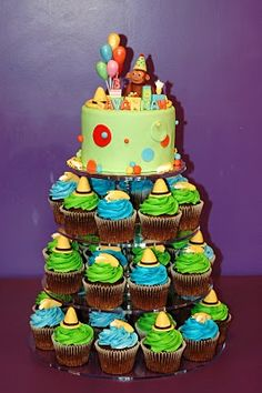 Curious George- cake on top, cupcakes below