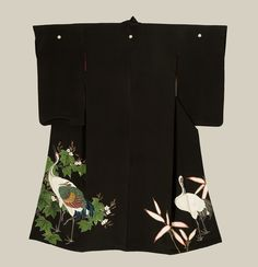 A large and striking 'chirimen' (crepe) silk antique kurotomesode featuring elegant cranes and paulownia masterfully created with yuzen-dyeing, sagara knot and simple embroidery. Late-Meiji period (1890-1911), Japan. The Kimono Gallery