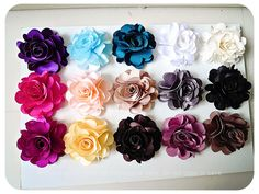 Satin flower to be used to clip onto hair, clothes or purse.