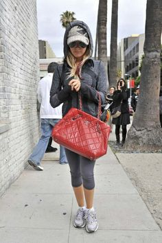 Ashley Tisdale carries her red Chanel purse as she heads out to shop on Robertson Blvd