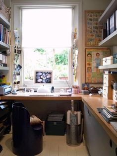 window office design with bookshelves. Really nice. Space small but imagine it opening up. Dreadful chair. I like the muted colours, peacefulness and lots of bookshelves w/ cupboards underneath.