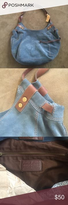 Never used blue suede Lucky Brand purse This is a Never Used Lucky Brand blue suede and brown leather detail purse. Two leather handles. Snap closure. Minor wear from storage but still in excellent condition. Smoke free home. Lucky Brand Bags Shoulder Bags