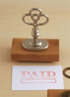 """""""Paid"""" Silver Key Stamp"""