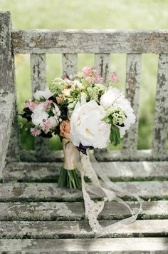 Falls Flowers | Tess & Billy's elegant spring wedding at Tyler Arboretum | Peony and rose bridal bouquet