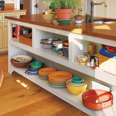 Give open shelves a chunky handcrafted look like the ones in this island by overlaying a face frame made of 1×3 poplar. About $1 per linear foot; Lowe's