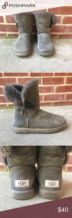 Grey Button UGGS This super cute short grey UGGS are the most comfy things your feet will ever walk in! Very warm and perfect for winter and to complete your outfits. Worn but still in good condition. UGG Shoes Winter & Rain Boots