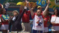 Joey Chestnut regains hot dog eating title, sets record