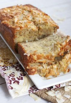 Triple Coconut Banana Bread 1/2 cup coconut oil 3/4 cup sugar 2 eggs 1 teaspoon vanilla extract 1/4 teaspoon coconut extract (optional) 1 1/2 cups all-purpose Flour 1 teaspoon baking soda 1/2 teaspoon salt 1/2 cup greek yogurt 1/2 cup sweetened, shredded coconut (plus more for sprinkling on top of loaf) 3 medium bananas, mashed