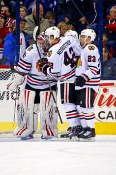 COLUMBUS, OH - APRIL 4: Joakim Nordstrom #42 of the Chicago Blackhawks congratulates Antti Raanta #31 after defeating the Columbus Blue Jackets 4-3 on April 4, 2014 at Nationwide Arena in Columbus, Ohio. (Photo by Kirk Irwin/Getty Images)