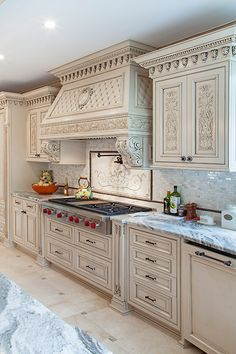 The traditional and rich art hand. Carving is the focal element in this mahagany kitchen. The painted finish in french provincial style, accentuates its details. Manufactured by WL Kitchen and Home in Lodi NJ Luxury Kitchen Design, Kitchen Room Design, Kitchen Cabinet Design, Home Decor Kitchen, Interior Design Kitchen, Custom Kitchens, Luxury Kitchens, Home Kitchens, Classic Kitchen