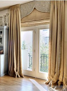 A triple layered window treatment for a sliding glass doors. To compliment other windows in the room I would use the cornice board without the drapes.