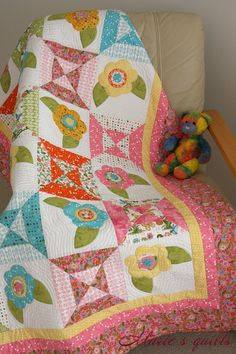 Looks like machine applique--very nice! Marie's quilts