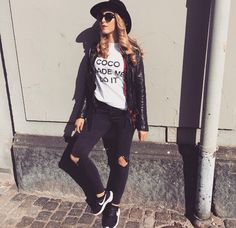 Black jeans, white top, red flannel, black leather m, black shoes