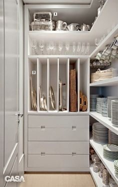 Wow! I love the shelving for cookie sheets. Out of the way because they aren't used that often, freeing up space for cutting boards in the main part of the kitchen. Also love the deep drawers for large serving pieces--no dust!