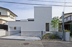 ninkipen! plans elevated courtyard inside family home in osaka