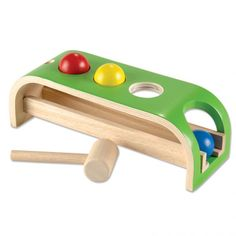 """Pound & Roll:Experience cause and effect in action! Toddlers will love how a bang of the hammer makes one of the colored balls slip through a hole, roll down the slanted track, and wait to be picked up and pounded again.   This all-wood set builds hand-eye coordination and strength. Includes three balls and 6"""" hammer. 12¾"""" x 4⅜"""" x 4⅛"""" high. Ages 1½ - 3 years."""