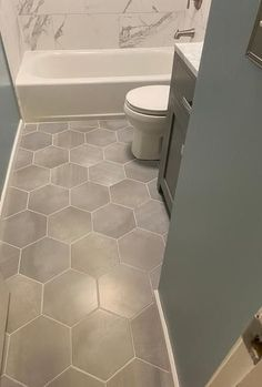#CheapWoodFlooring Hexagon Tile Bathroom, Small Bathroom Tiles, Bathroom Flooring, Hexagon Floor Tile, Master Bathroom, Tile Flooring, Washroom, Bathroom Designs, Bathroom Remodeling