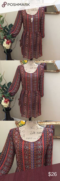 """🦄Band of Gypsies stunning BOHO peasant dress! 🦄Band of Gypsies stunning flowy lightweight BOHO peasant dress! This is a beautiful tribal BOHO hippie chic dress with pockets! Very lightweight with three quarters sleeves. Has a small tie in the back for added style points. Preloved in excellent condition. Pit to pit measurement is 17"""". No stretch. Waist 15"""". No stretch. Length is 31"""". Band of Gypsies Dresses Midi"""