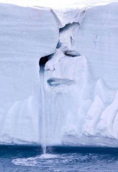 A dramatic picture taken by Michael Nolan has been dubbed the face of Mother Nature crying on a canvas of melting ice and cascading water on an ice cap located on Nordaustlandet, in the Svalbard archipelago of Norway. The tears of this natural sculpture were created by a waterfall of glacial water cascading from one of the face's eyes, thus painting an alarming picture warning the world about the effects of Global Warming.
