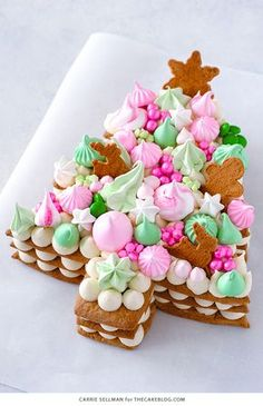 Cream Tart Tree Cake - shaped like a Christmas tree, this holiday version of the popular cream tart number cake has gingerbread cookies, cream cheese frosting with meringue kisses, chocolate, sprinkles! Holiday Cakes, Christmas Desserts, Christmas Treats, Christmas Baking, Christmas Tree Cake, Christmas Cupcakes, Pink Christmas, Xmas, Cream Cheese Cookies
