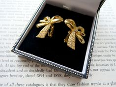 1980s Goldtone Diamante Bows Clip On Earrings via LovesVintage43. Click on the image to see more!