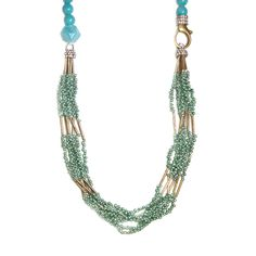 "Colorful and unconventional, this 34"" long necklace has a string of round teal beads, pave crystal beads and a section of six strands of opalescent teal seed beads with brass tubes throughout.Wear it multiple ways showing a combination of the patterns. Devastatingly chic."