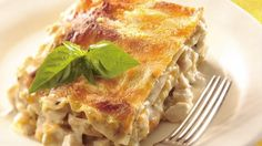 Craving comfort food?  Try this creamy lasagna with layers of tasty chicken and four cheeses.