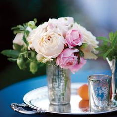 Brides.com: Simple Floral Wedding Centerpieces. A Silver Tray Filled with Peonies