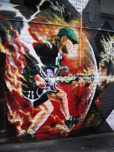 Angus Young street art in ACDC Lane Melbourne. For decades, AC/DC have been belting out hits and concerts continue, albeit with a somewhat replaced line-up of band members, Angus being the only original member left. Formerly Corporation Lane (1 of over 1,500 in Melbourne). With the band's close ties to Melbourne, it was only fitting that these legends of rock & roll were given a laneway bearing the group's name.